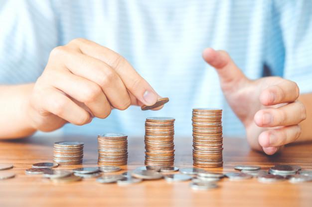 saving-money-concept-man-hand-putting-coin-stack-finance-budget_18497-972